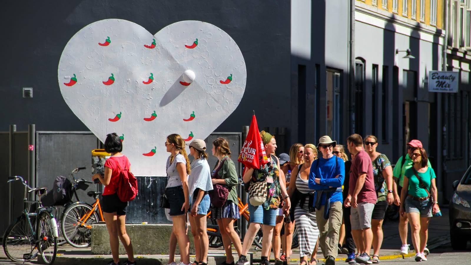 SANDEMANs Copenhagen Alternative Tour group crossing the street