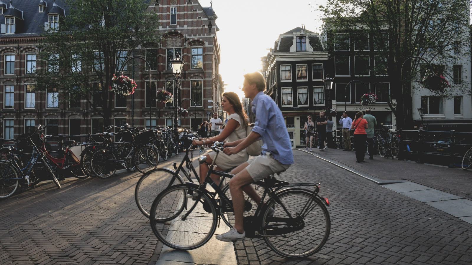 people riding bikes in amsterdam