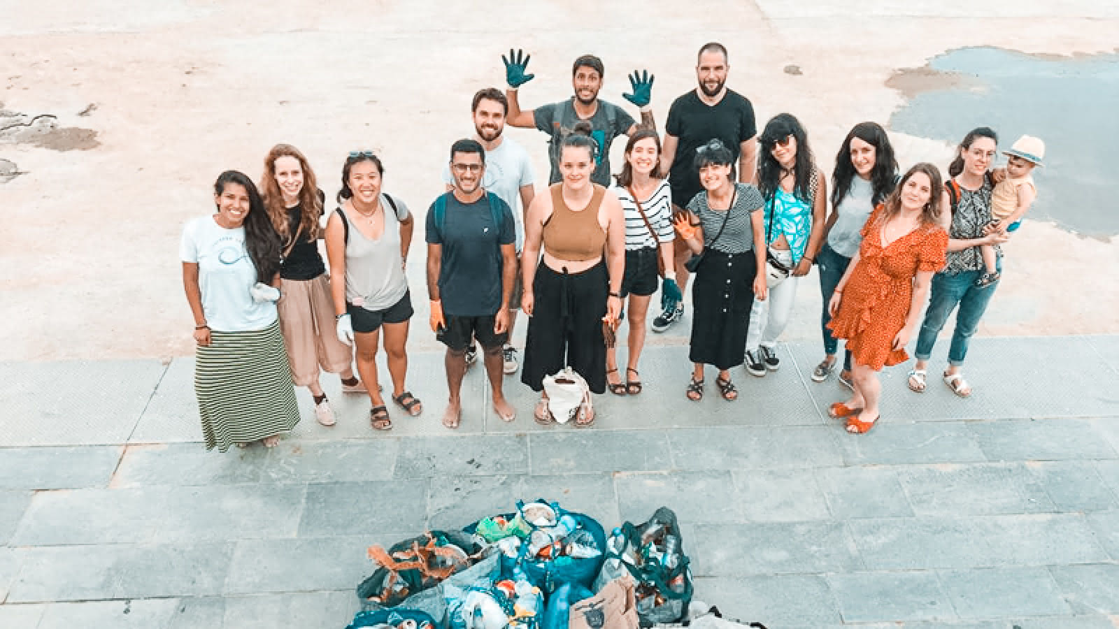 group photo at the end of the barcelona beach clean up event
