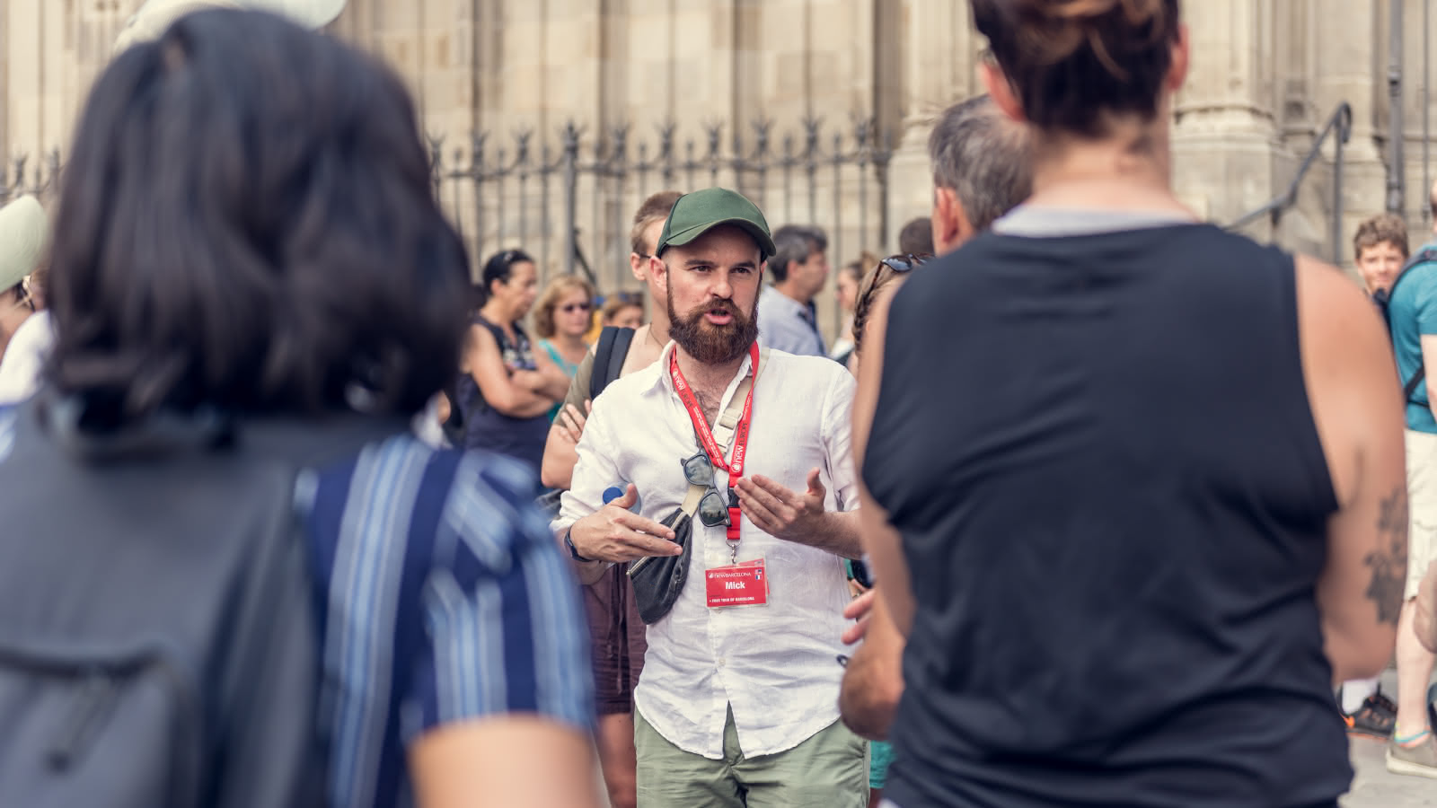 free tour guide showing barcelona's gothic quarter to the guests