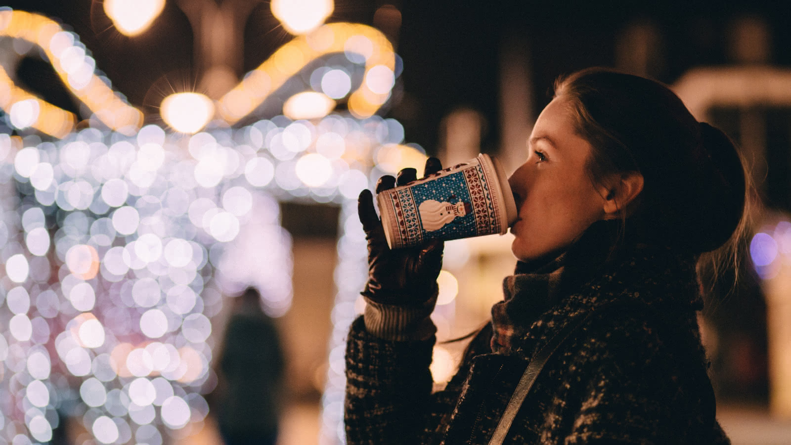 girl with a hot drink in winter